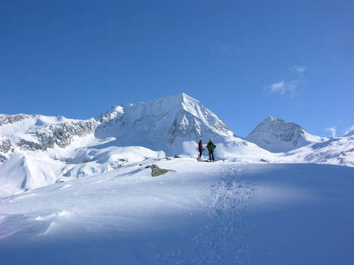 Ski touring surrounded by a great winter scenery.